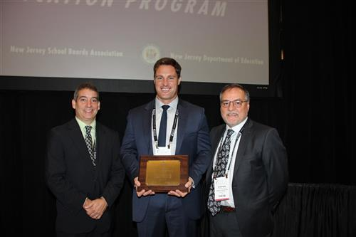 Robert Rotante, Shawn Levinson and Stephen Genco Accept Outstanding Program Award