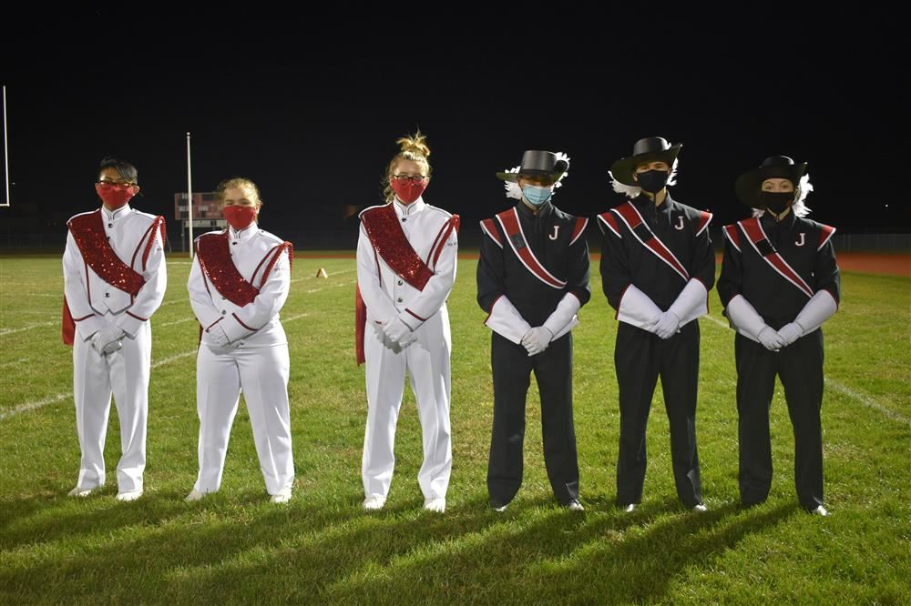 band members standing on field