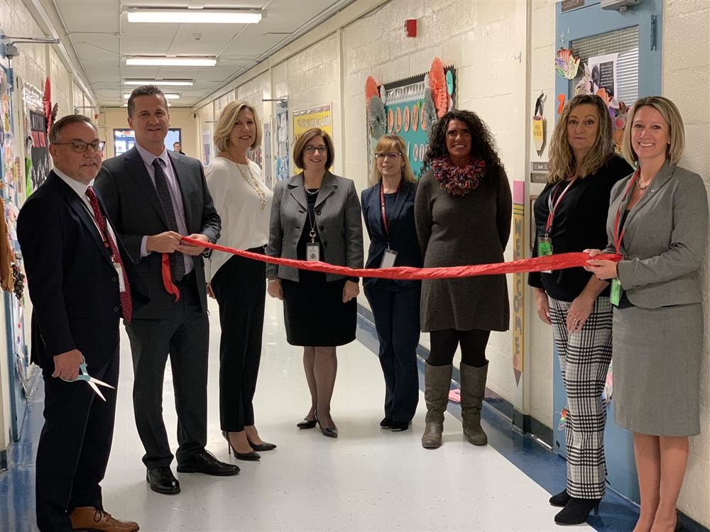 Switlik cuts the ribbon on the new Model Classroom
