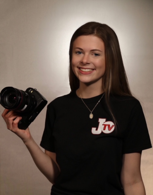 Photo of Rebecca Chiafullo holding a camera