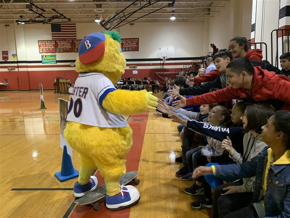 Buster from the Blue Claws visits with kids during the Project Fit Opening