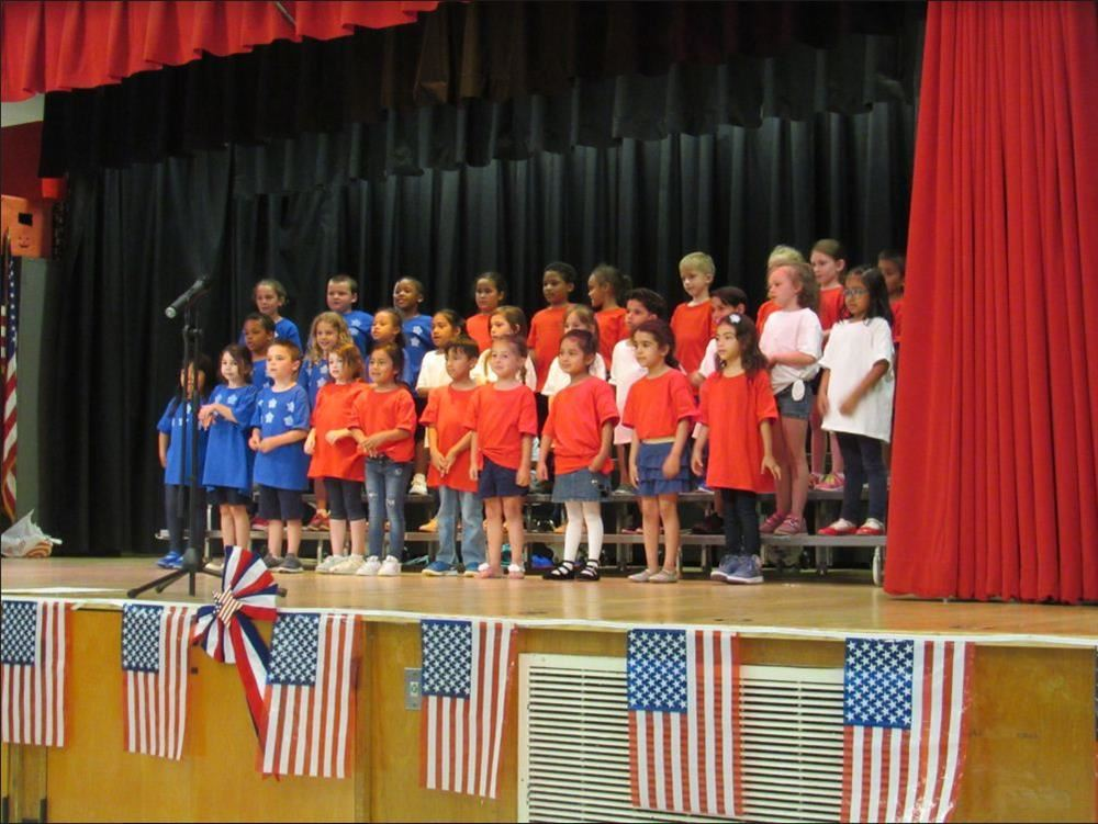students celebrating Flag Day on stage