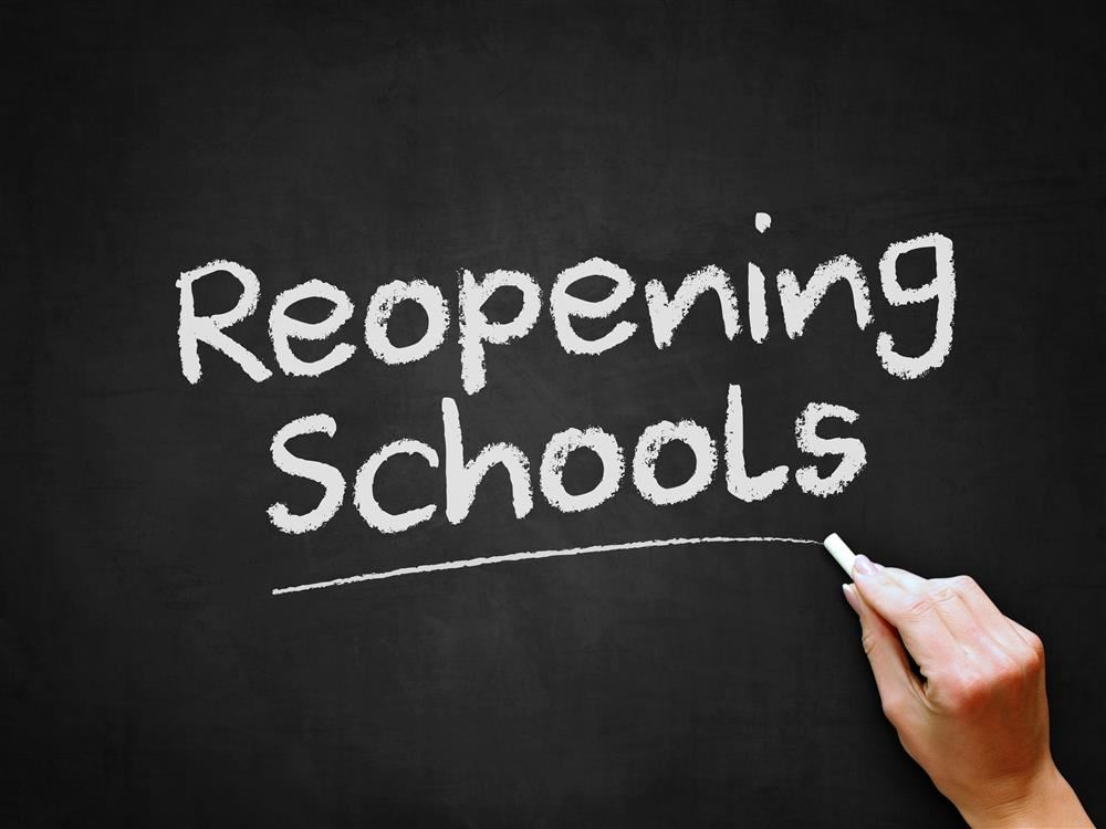 reopening schools chalk sign