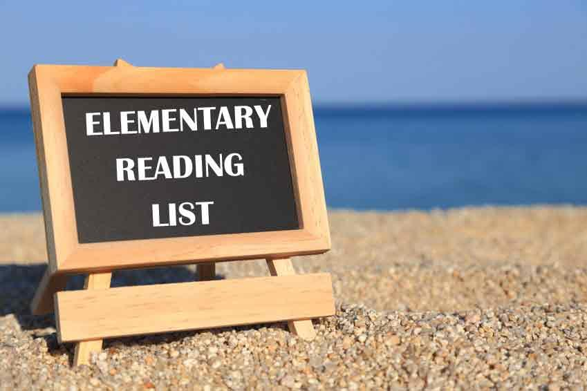 elementary reading lists written on an easel in the sand